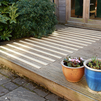 Buff non-slip strips added to slippery timber platforms.