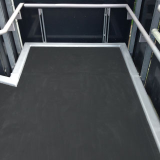 Custom cut anti-slip floor sheets for platforms and ramp areas.