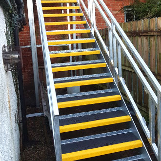 Yellow and white Stair Treads exit stairway.