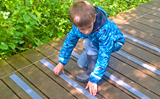 Non-slip decking strips for wooden footbridges at Harrington Reservoir Local Nature Reserve.