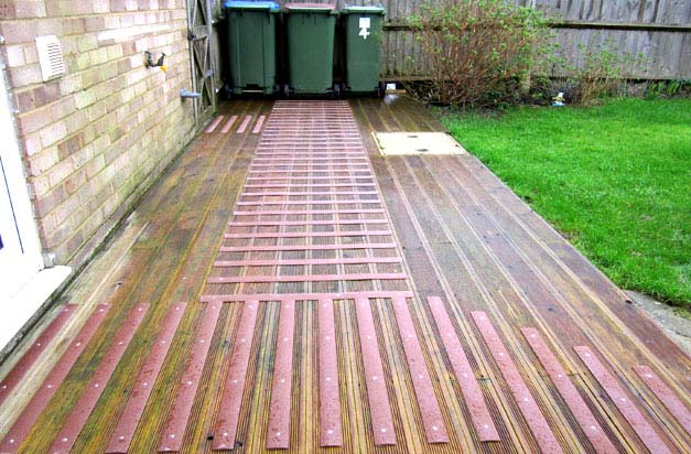 Back garden decking and bin area - a potential slip hazard made safe with decking strips.