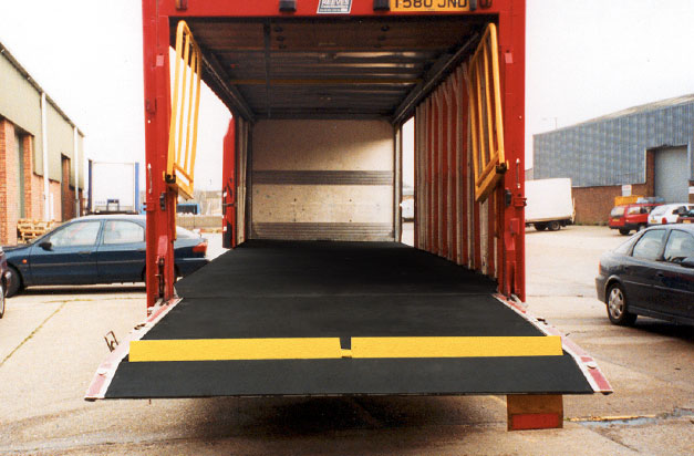 Anti-flip Floor covers applied to vehicle interior floor and ramp areas.