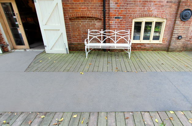 GRP floor sheets on slippery wooden decking areas at Snape Maltings.