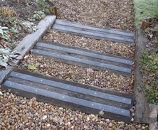 Non-slip decking strips on slippery wooden sleepers.